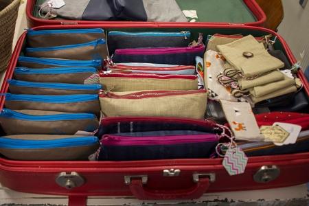 Het naaiatelier pup-up-winkel koffers